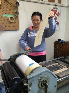 Shayn Jiang finishes her broadside letterpress print in class