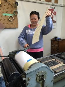 Shayn Jiang finishes her broadside letterpress print in class